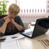woman paying bills shutterstock