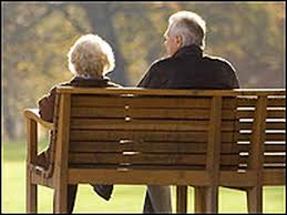older couple park bench