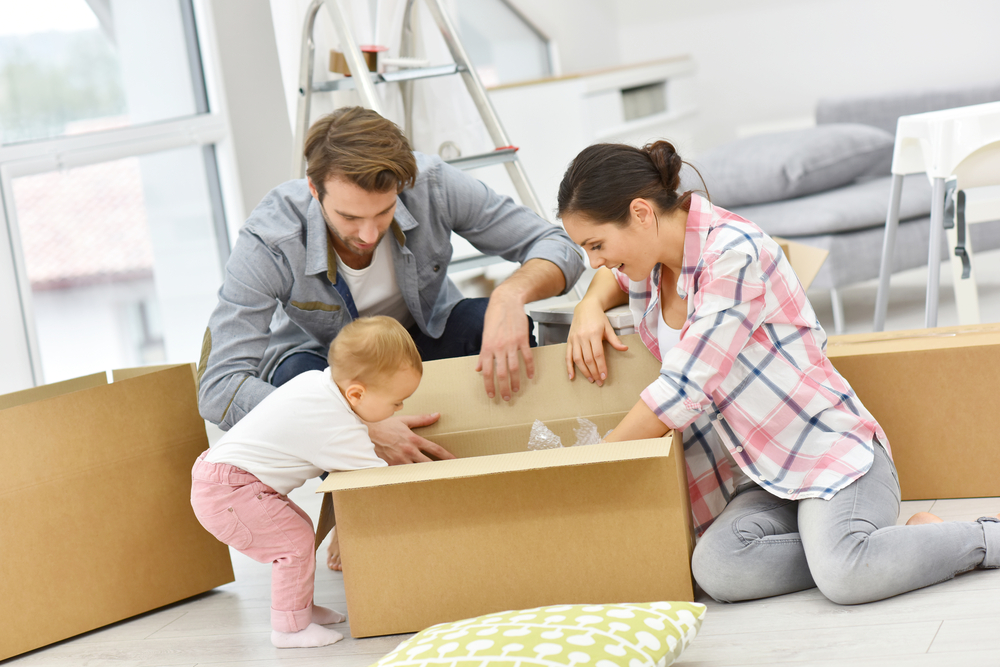 young-couple-unpacking-shutterstock_338701448