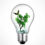 Lightbulb with bonsai plant and butterfly inside - Ecology and environment idea